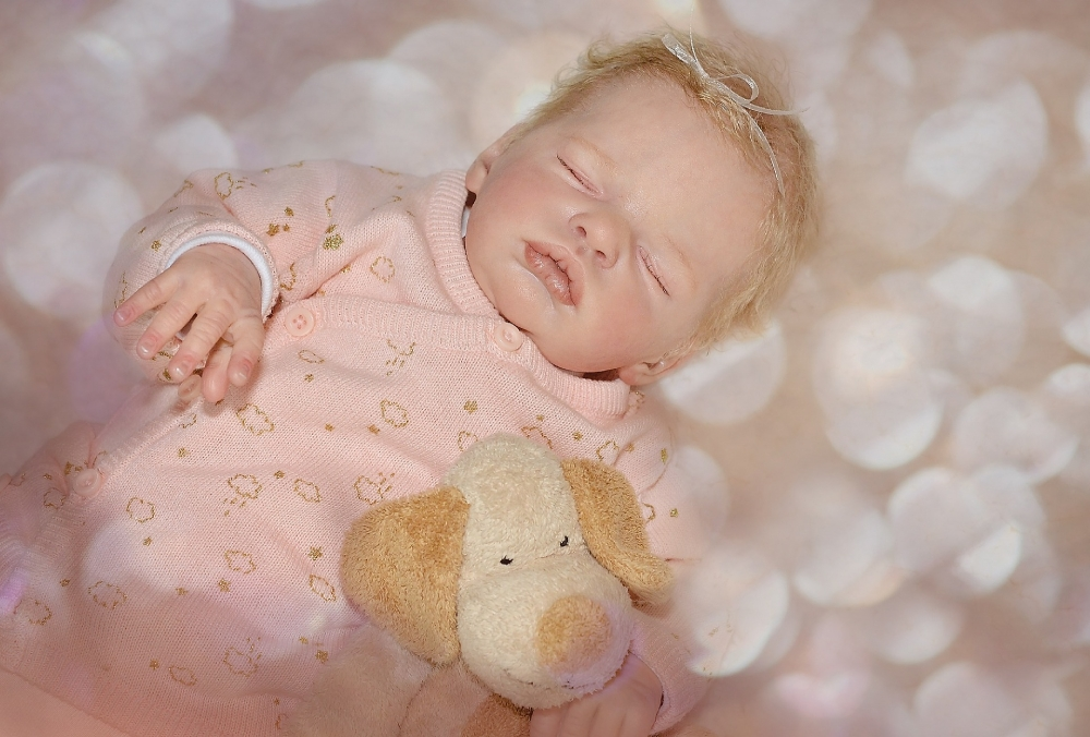 Reborn dolls... cute or creepy?